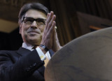 Texas Gov. Rick Perry (R) spoke to delegates at the state party convention Thursday. (AP Photo/Susan Walsh, File)