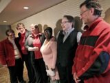 Plaintiffs in a federal lawsuit challenging Wisconsin's ban on gay marriage appear during a press conference at the Madison Concourse Hotel in Madison, Wis. in November, 2013. (Photo: Pool photo, AP)