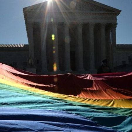 Justice Department reverses Trump anti-LGBTQ memo on high court ruling